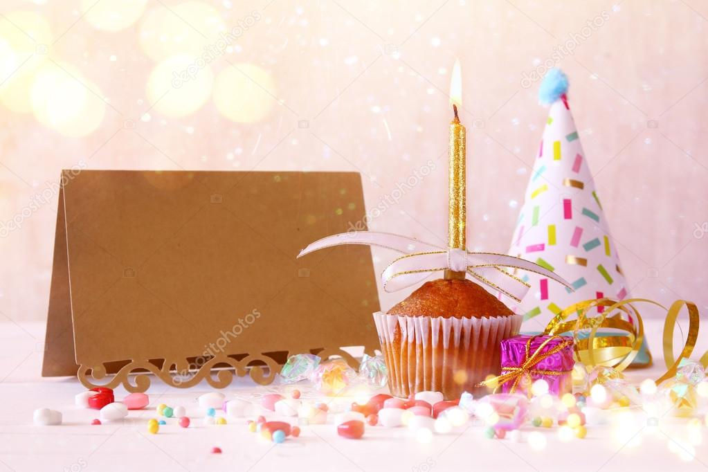 Birthday Concept With Cupcake Next To Empty Greeting Card Stock