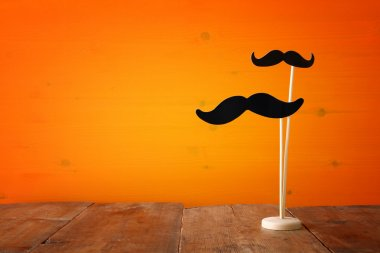 Halloween holiday concept. Funny paper moustache