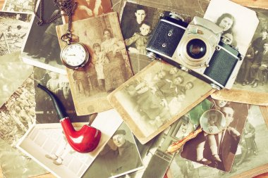 Top view of old camera, antique photographs and old pocket clock