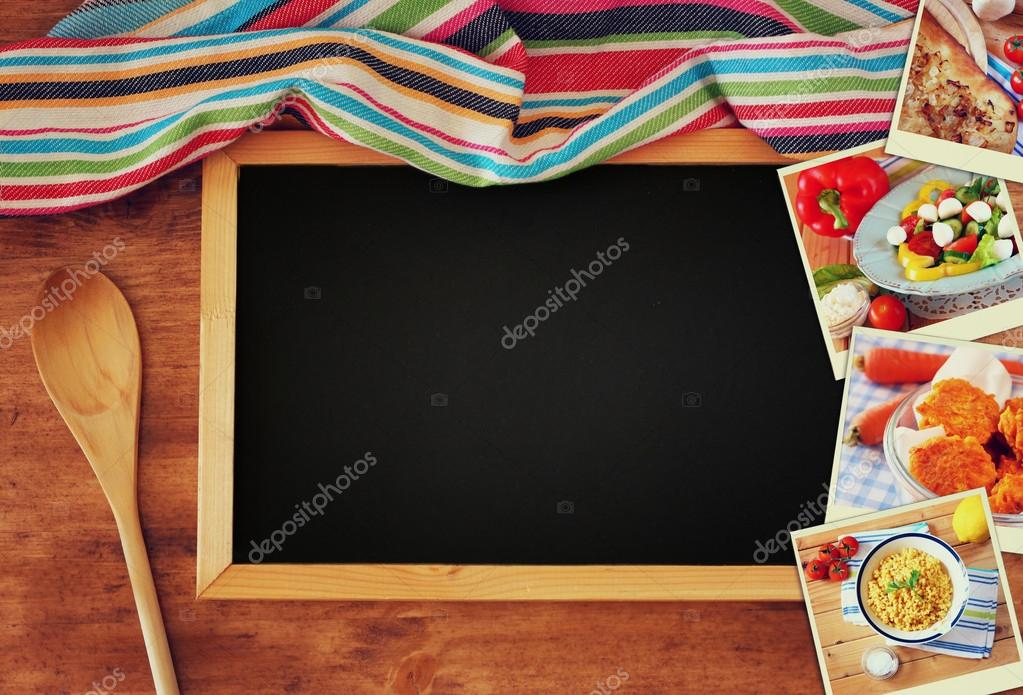 Top view of blackboard and wooden spoon over wooden table and collage of photos with various food and dishes