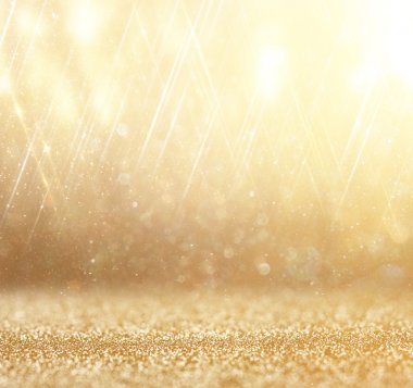 Glitter vintage lights background. abstract gold background . defocused