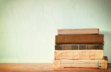 Old books on a wooden table. retro filtered image