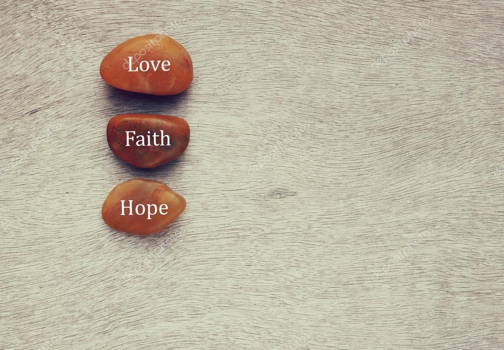 River stones with words written on them. love, and family concept