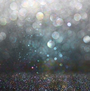 Glitter vintage lights background. gold, silver, blue and black. de-focused.