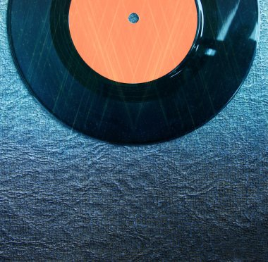 Top view of record over textured background and glitter lights