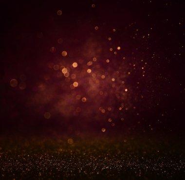 Abstract dark bokhe lights background , purple,black and subtle gold. defocused background