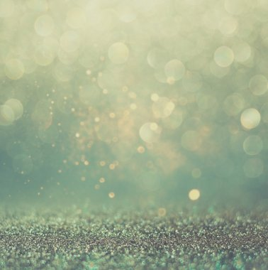 Glitter vintage lights background. gold, silver, blue and black. de-focused.