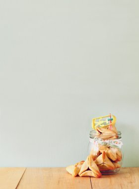 Hamantaschen cookies or hamans ears Purim celebration (jewish holiday). filtered image