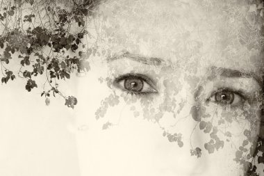 Double exposure image of young girl and nature background. black and white style photo