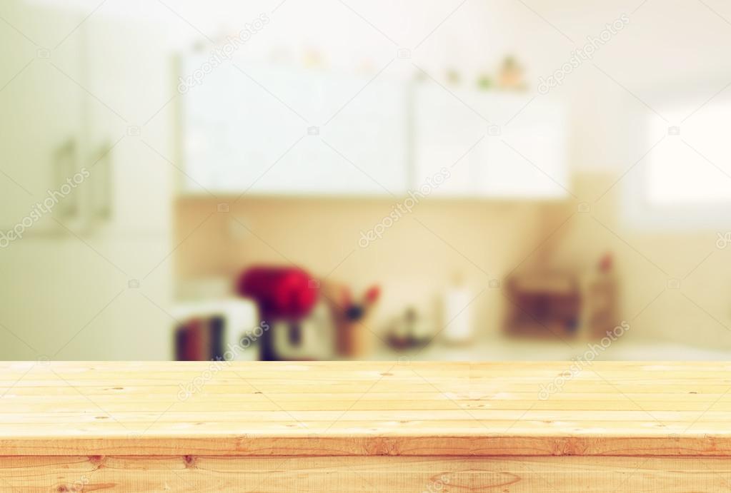 Empty table board and defocused white retro kitchen ...