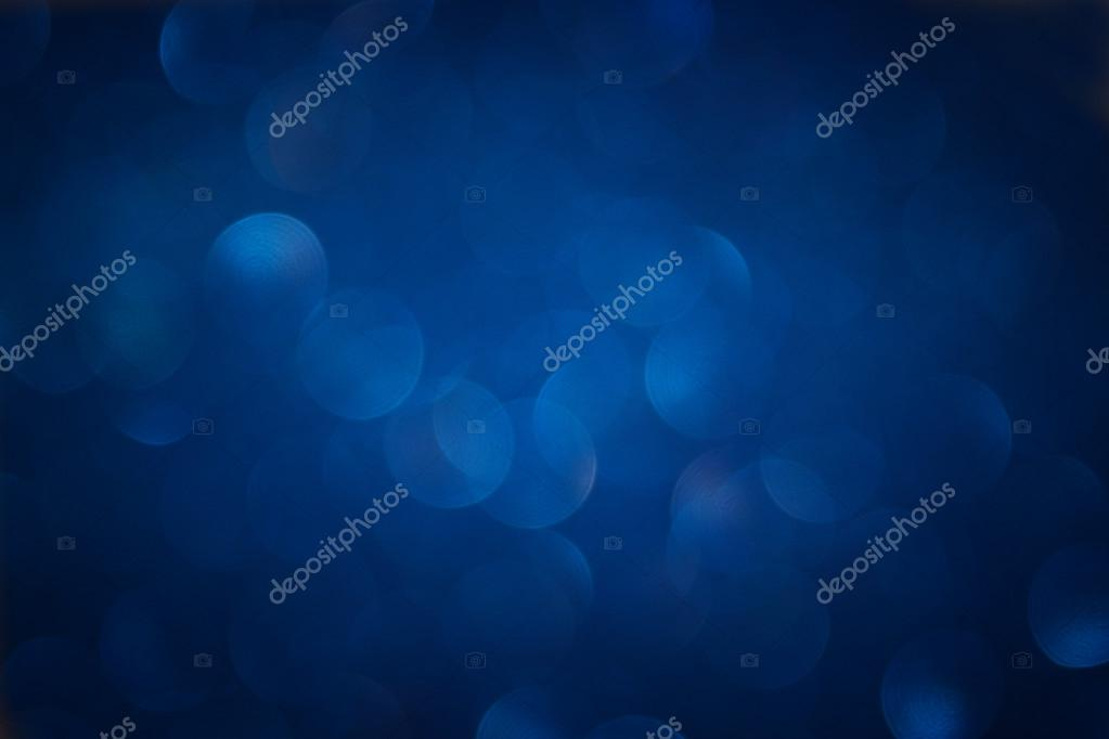 glitter vintage lights background. light silver, blue and black. defocused.