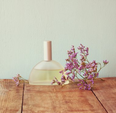 Perfume bottle with flowers