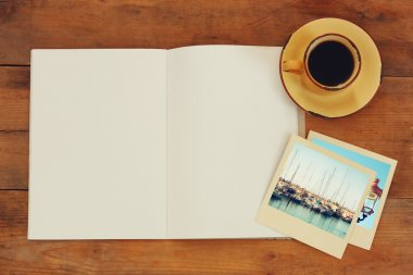 Open blank notebook and photos