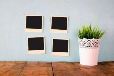 Blank instant photos on the wall