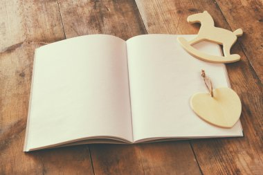 Notebook and wooden horse toy