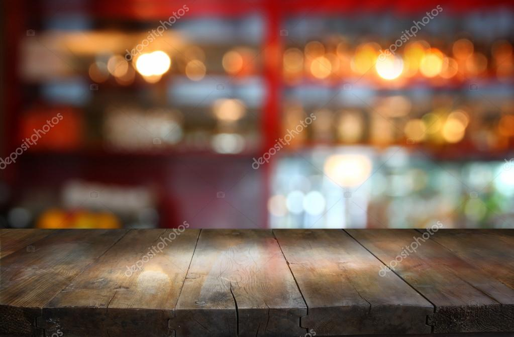 wooden table in front of blurred background