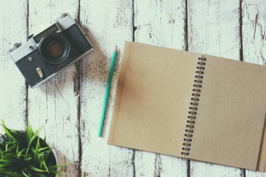 blank notebook and old camera