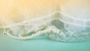 Wedding vintage crown of bride, pearls and veil. wedding concept. retro filtered and toned