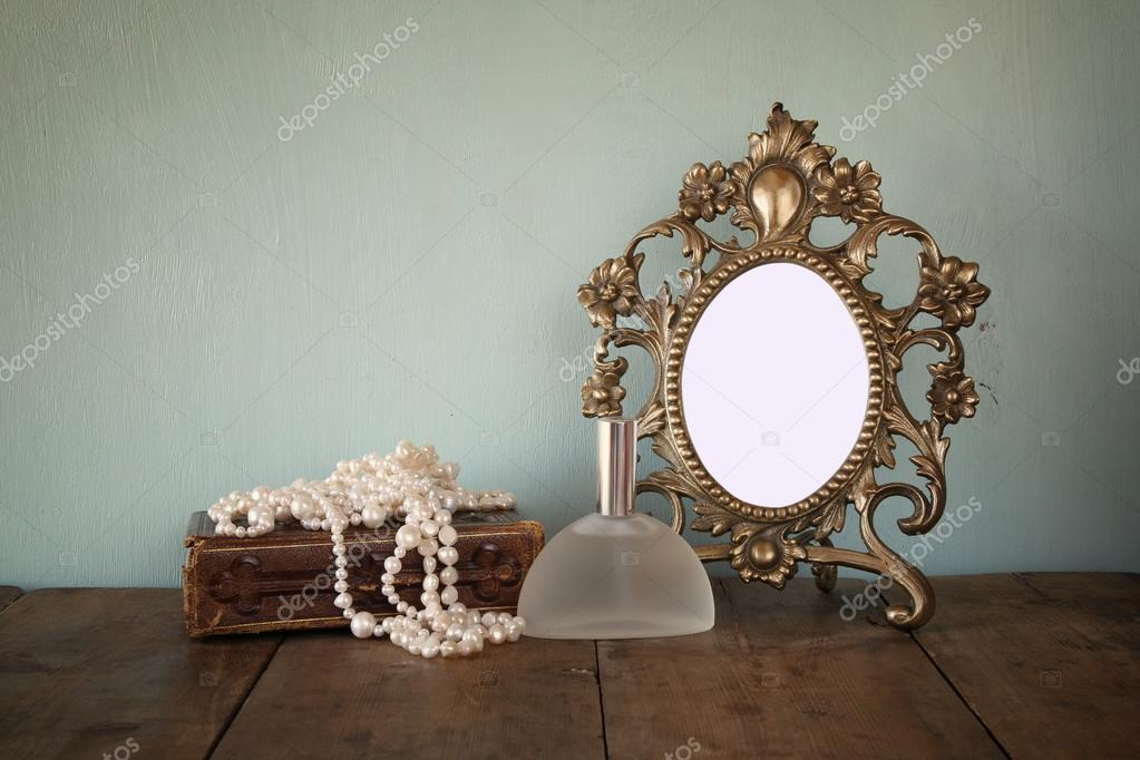 antique blank victorian style frame and old book with vintage pearl