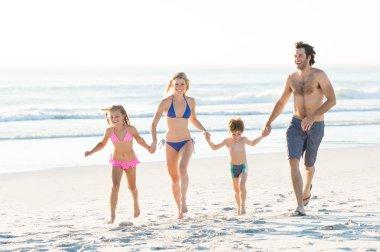 Family running at beach