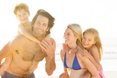 Parents with children at beach