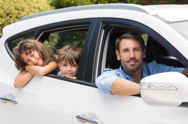 Man in car with children