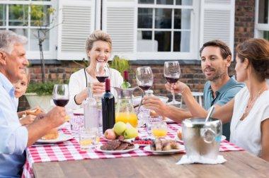 Family raising a toast