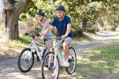 Couple cycling at park