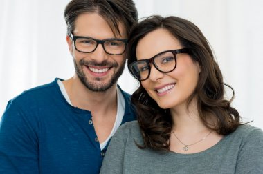 Smiling happy couple in spectacles