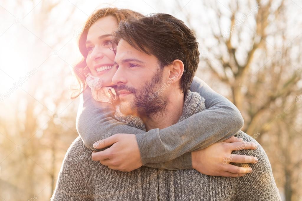 Happy couple hugging outdoor