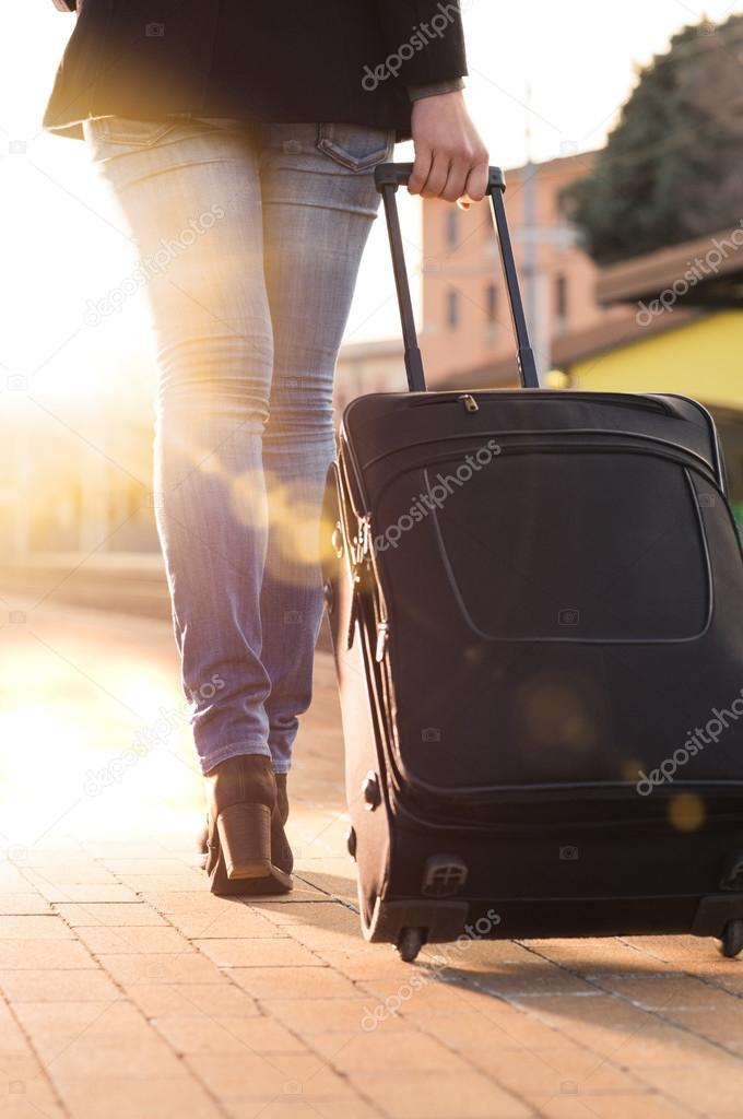woman leaving with luggage - 598×900
