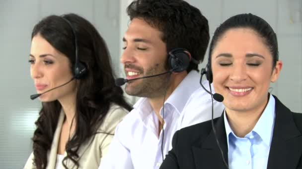 Woman with colleagues at call center