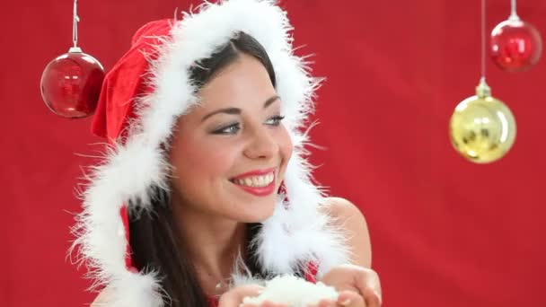 Santa claus girl blowing white snowflakes