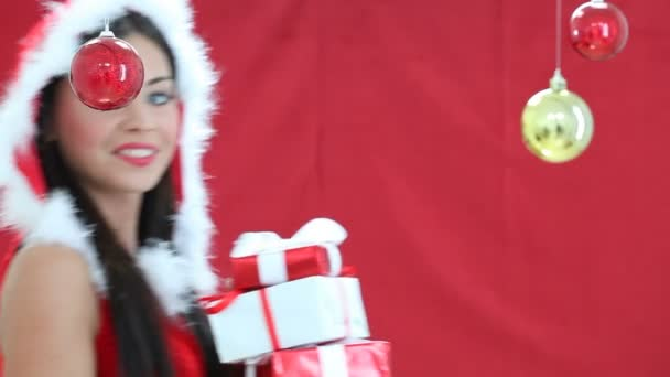 Woman in Santa Claus clothes holding a red gifts