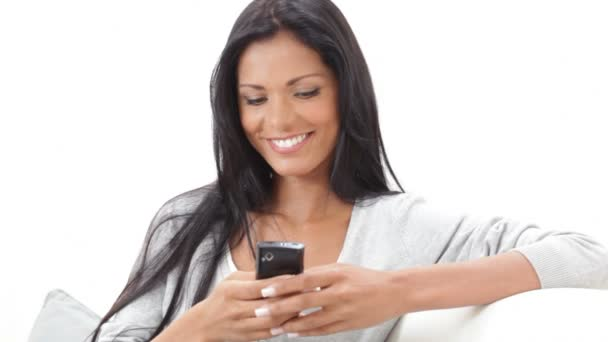 Woman text messaging with her smart phone