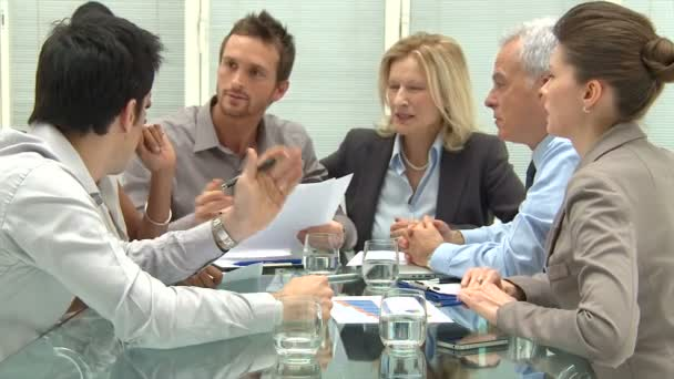 Coworkers discussing in conference room