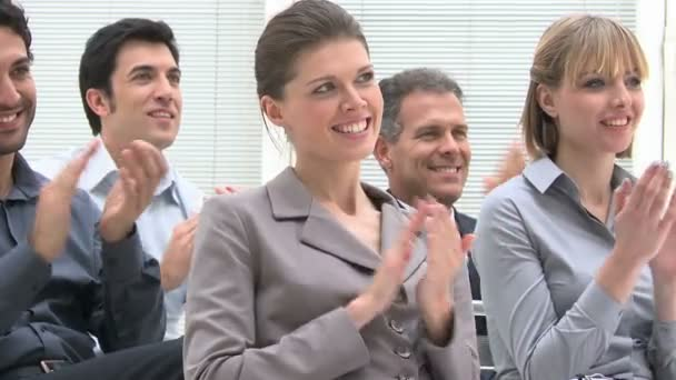 People clapping hands on a meeting conference