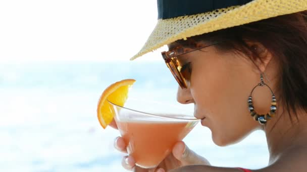 Woman drinks a cocktail for the aperitif