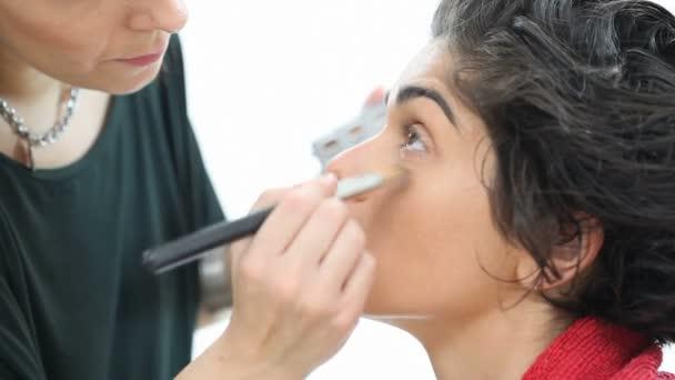 Woman applying highlighting concealer
