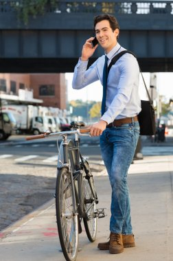 man with bicycle talking on phone