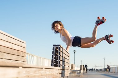 Woman jumping with roller skates