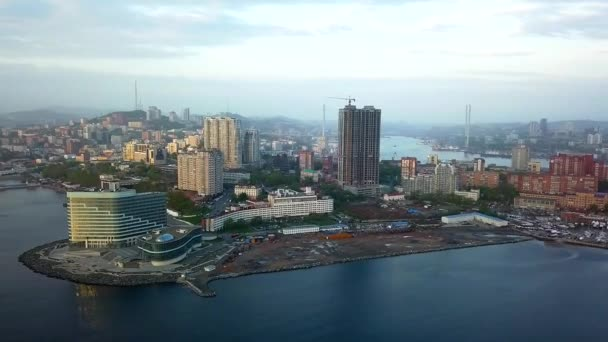 Drone view of the city and marina located on the peninsula at sunset