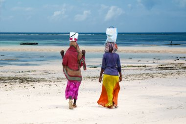 Women at  the beach, Zanzibar island, Tanzania