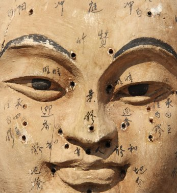 Ancient wooden acupuncture face