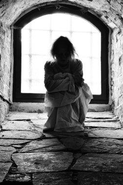 Woman in cellar