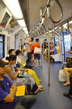 Passengers ride on subway train