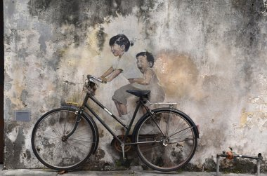 Little Children on a Bicycle street art mural by Lithuanian arti