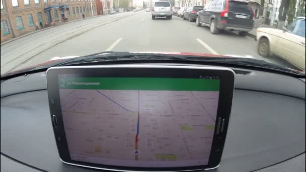 UFA, RUSSIA - SEPTEMBER 22, 2015: A car driver using a Google Navigator application on Android device Samsung. Google Navigator is a most popular web mapping service for mobile provided by Google inc.