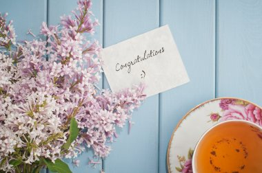 Congratulations card in summer bouquet of gentle blooming lilac