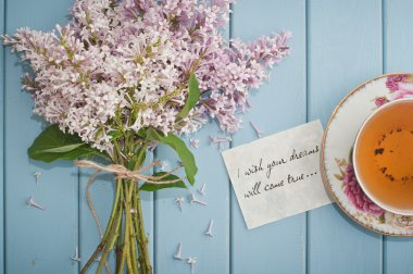 Motivational card in summer bouquet of gentle blooming lilac  an